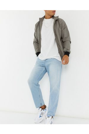 ASOS Relaxed tapered jeans in vintage light blue stone wash