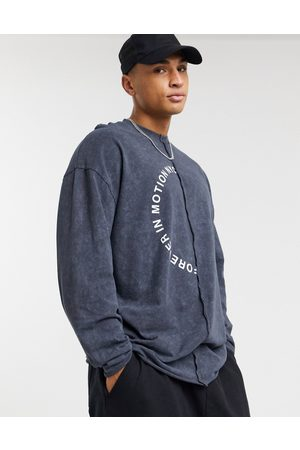 ASOS Oversized long sleeve t-shirt with exposed seam circle text front print in black acid wash-Grey