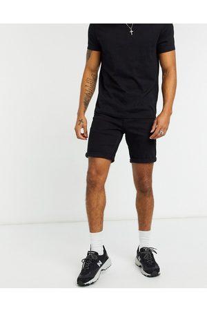 ASOS Slim denim shorts in black