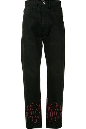 A BATHING APE® Flame-print straight-leg jeans