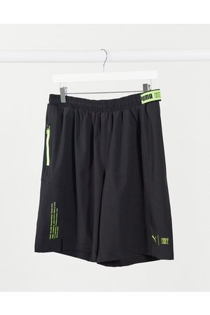 PUMA Training shorts in black with graphic logo