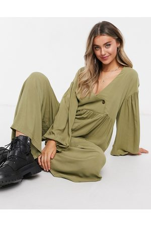 ASOS DESIGN Wrap smock jumpsuit with button in khaki-Green