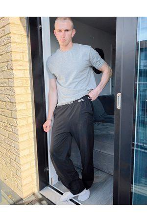 ASOS Lounge pyjama bottoms in black
