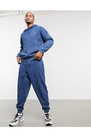ASOS Co-ord oversized joggers in blue acid wash-Green