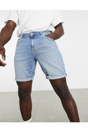 ASOS Slim denim shorts in mid wash blue