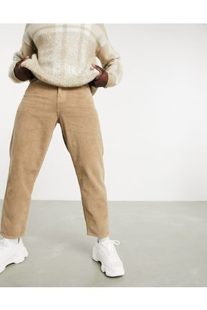 ASOS Relaxed tapered corduroy jeans in light brown