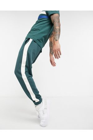 ASOS Co-ord tapered joggers with side stripe in deep green