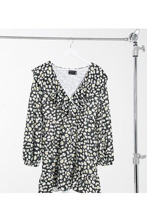 ASOS ASOS DESIGN Curve mini wrap dress with frill neck and pep hem in black base daisy print