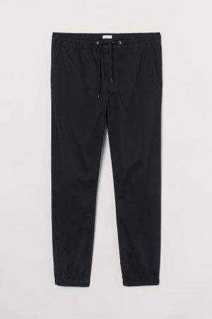 H&M Homem Calças Chino - Joggers em sarja de algodão