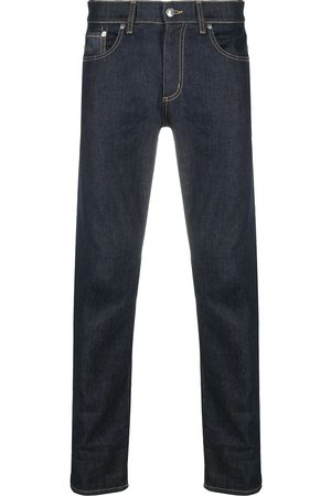 Alexander McQueen Studded logo slim-fit jeans