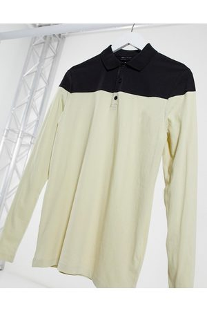 ASOS DESIGN Polo shirt with contrast yoke in beige