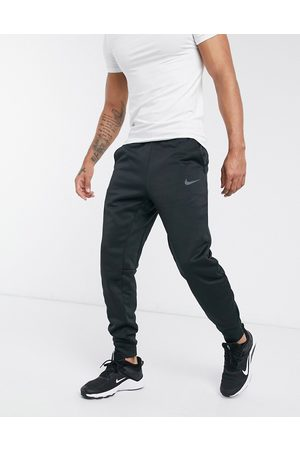 Nike Therma tapered joggers in black
