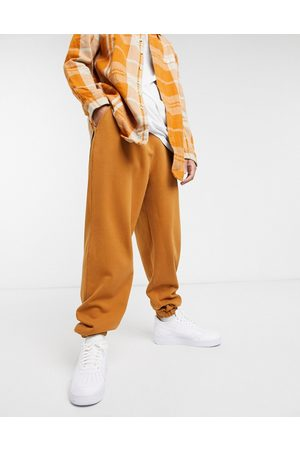 ASOS Super oversized joggers in washed brown
