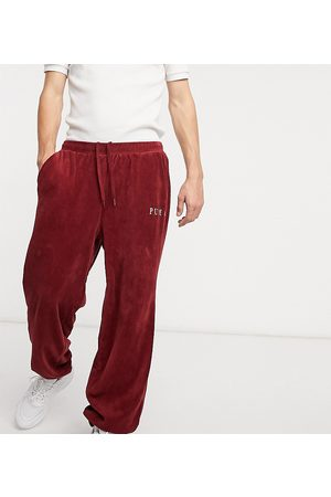 PUMA Homem Joggers - Cord joggers in burgundy exclusive to ASOS-Red