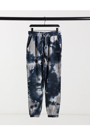 The Couture Club Marble wash relaxed fit co-ord joggers in navy