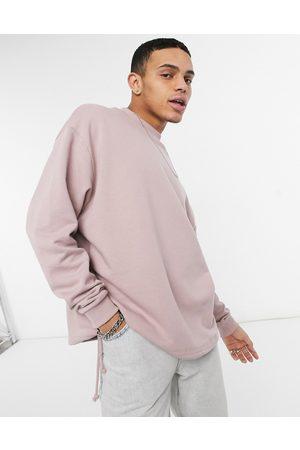 ASOS Oversized sweatshirt with drawcord hem in pink