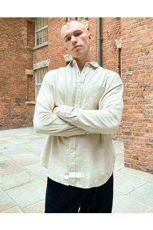 ASOS 90s oversized flannel shirt in beige