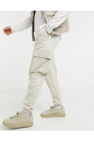 ASOS Tapered cargo joggers with woven cargo pockets in beige