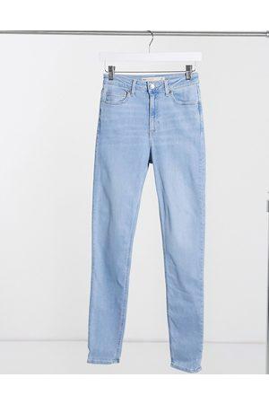 ASOS DESIGN Senhora Skinny - High rise ridley 'skinny' jean in stonewash-Blue
