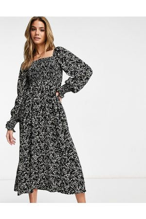 Missguided Long sleeve midi dress with shirred bust in black ditsy floral