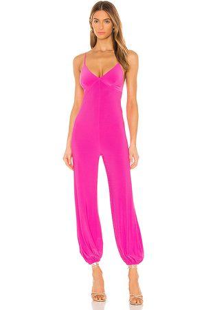 Norma Kamali X REVOLVE Slip Jog Jumpsuit in - Pink. Size L (also in M, S, XS, XXS).
