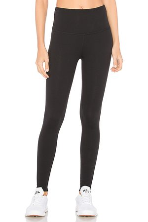 Beyond Yoga High Waisted Midi Legging in - Black. Size L (also in M, S, XS).