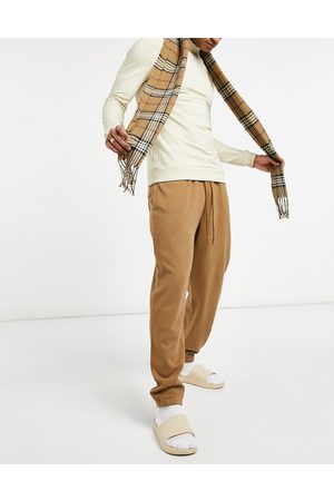ASOS Homem Joggers - Oversized joggers with narrow waistband in washed brown