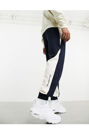 PUMA X Central Saint Martins logo sweatpants in navy with white detail