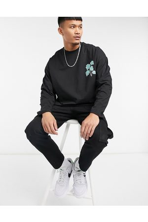 ASOS Oversized long sleeve t-shirt in black with leaf print