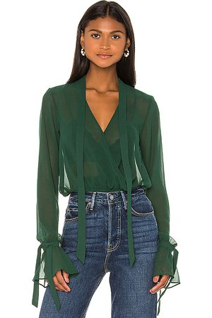 House of Harlow 1960 Senhora Blusas - X REVOLVE Joli Tie Cuff Blouse in - Green. Size M (also in S, XS).