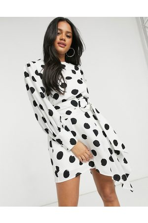 Forever U Belted asymmetric mini dress with elongated cuffs in oversized spot-White