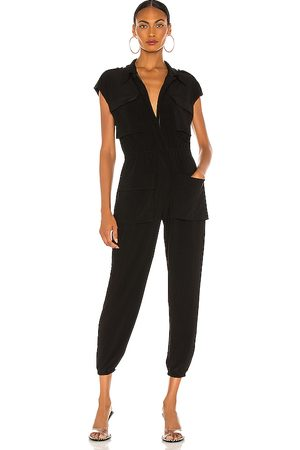 Norma Kamali Sleeveless Cargo Jumpsuit in - . Size M (also in XXS, XS, S).