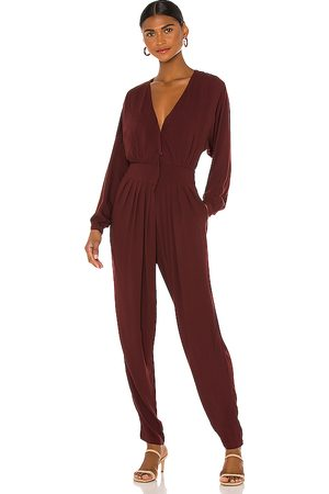 Indah Gianyar Pleated Jumpsuit in - Wine. Size L (also in XS, S, M).