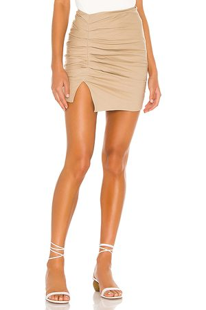 Lovers + Friends Zanele Mini Skirt in - Tan. Size L (also in XS, S, M, XL).