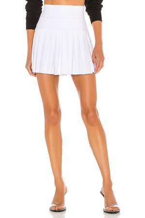 Norma Kamali Pleated Mini Skirt in - White. Size L (also in XS, S, M).