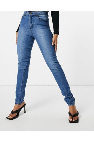 Femme Luxe Straight leg jean with distressed bum detail in mid wash-Blue