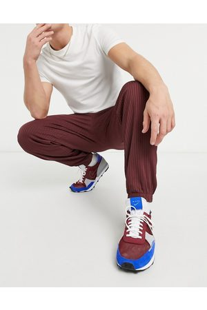 ASOS Co-ord tapered rib joggers with fixed hem in burgundy