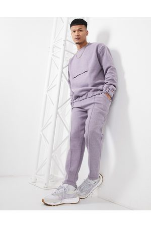 ASOS Smart co-ord tapered joggers with fixed hem & pin tucks in boiled wool look texture-Purple
