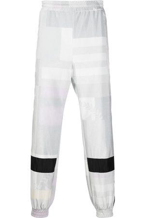 KOCHÉ Square print track pants