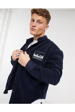 ASOS 90s oversized navy fleece shirt with chest embroidery