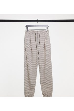 COLLUSION Unisex straight leg joggers in heritage check-Brown