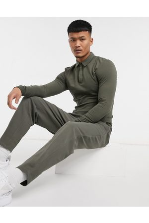 ASOS Homem Joggers - Smart co-ord tapered joggers in pique with fixed hem in deep khaki-Green