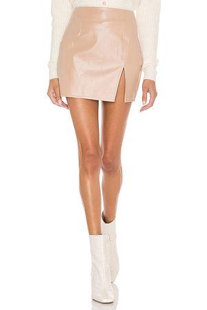 superdown Trinity Faux Leather Skirt in - Beige. Size L (also in M, S, XL, XS, XXS).