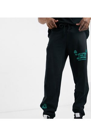 COLLUSION Joggers with print-Black