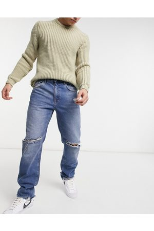 ASOS Homem Retos - Original fit jeans in vintage mid wash with knee rips and destroyed hem-Blue