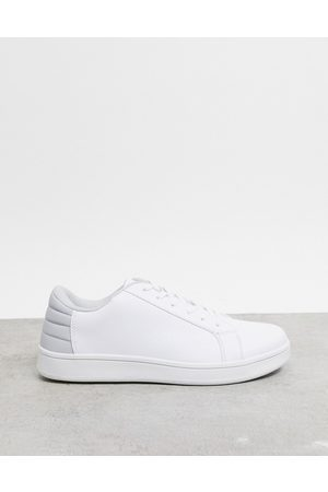 Truffle Collection Lace up trainer in white with grey tab