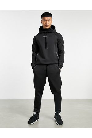 ASOS Co-ord tapered joggers in black scuba with Roman numerals printed zips