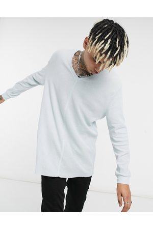 ASOS Relaxed long sleeve t-shirt with deep v neck in light blue