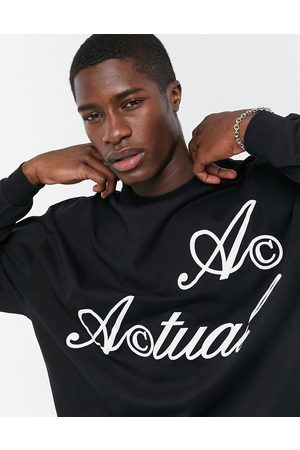 ASOS Actual Oversized long sleeve t-shirt in black with logo