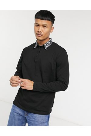 ASOS Relaxed long sleeve polo with contrast collar in black